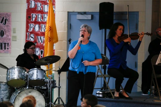 """Ericka Van Eckhoutte sings the title theme to """"Beauty and the Beast"""" Tuesday during a Young Audiences concert for the students at Park Avenue Elementary School in Aztec."""
