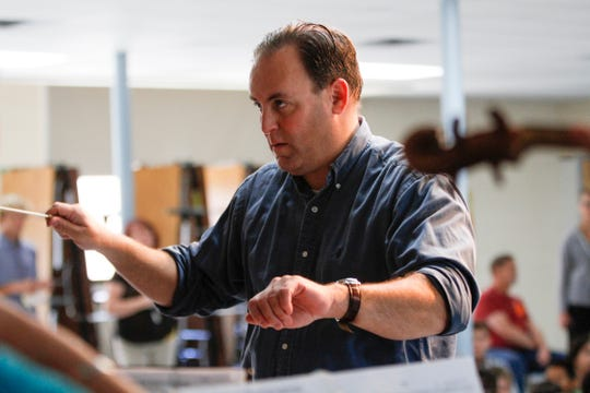 Conductor Teun Fetz leads his orchestra Tuesday during the Young Audiences concert for students at Park Avenue Elementary School in Aztec.