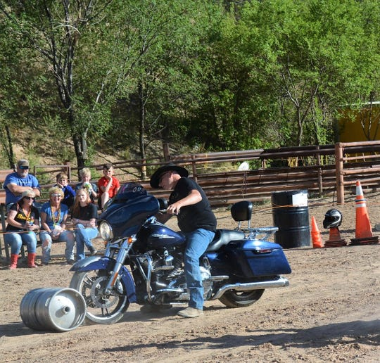 A motorcyclist challenges himself in the keg-rolling contest during Rodeo On Wheels this past May.