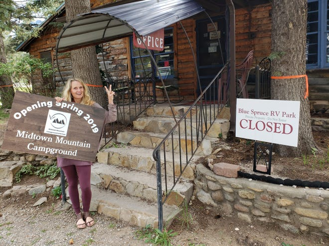 Anna Dozier stands next her and Rich Dozier's new business after selling the Happy Hiker Ruidoso.