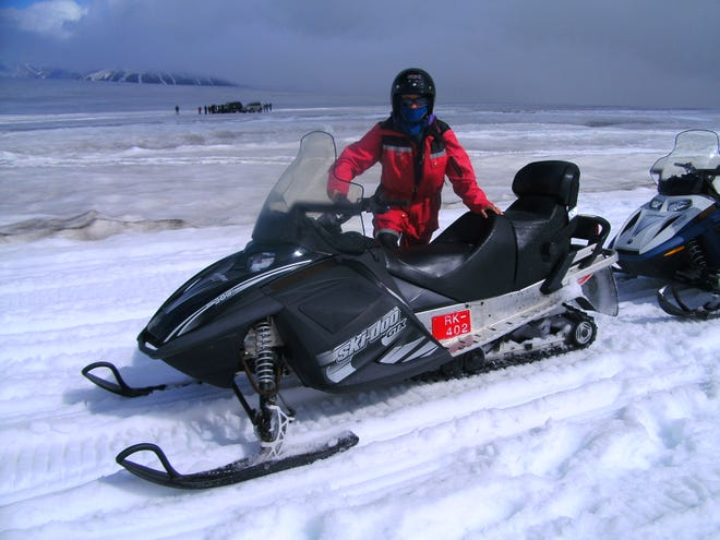Columnist Yvonne Lanelli tried driving the snowmobile along Mýrdalsjökull glacier but soon decided it was more fun to ride behind.