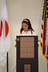 Niji-Iro student Melanie Delphia translated the speeches during the all-school assembly.