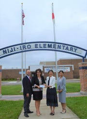 Nji-Iro administrator Lawrence Deluca (from left), Livonia Public Schools Superintendent Andrea Oquist and Yuki Sakai and Mayuko Chashiro, both of the Consulate General of Japan-Detroit.