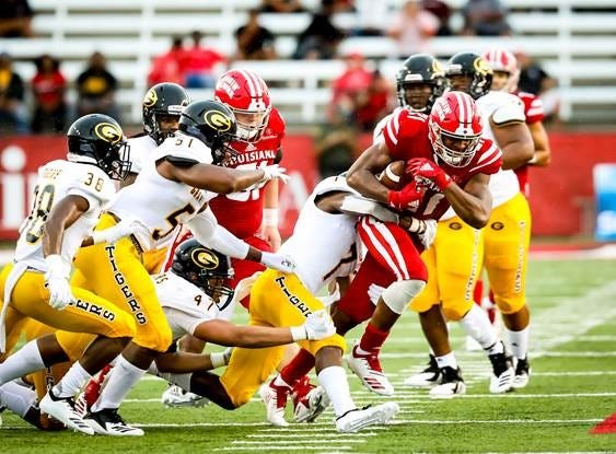 UL's Keenan Barnes (21) fights a tackle during the Cajuns' Week 1 game against Grambling State at Cajun Field.