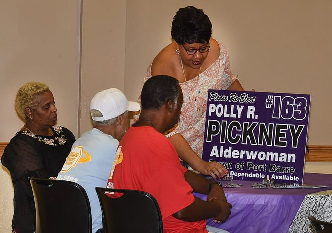 Polly Pickney, candidate for Port Barre Alderman, talks with voters at Monday night's candidate meet-and-greet, sponsored by the St. Landry Federation of Democratic Women. The event was held at the Opelousas Civic Center.