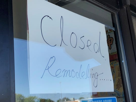 A sign on the China King reads that the restaurant will be closed for about one month.