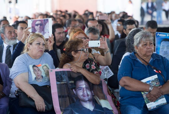 "Women hold photographs of their missing persons hang during the 6th public forum on ""Pacification and National Reconciliation"" at the Uiniversidad Iberoamericana Tijuana on September 11, 2018."