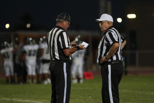 John Gunderson, left, and Rick Sherwood talk during a timeout at the Desert Hot Springs football game against Jurupa Valley, Desert Hot Springs, Calif., September 6, 2018.