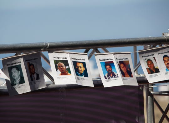 "Photographs of missing persons hang during the sixth public forum on ""Pacification and National Reconciliation"" at the Uiniversidad Iberoamericana in Tijuana on September 11, 2018."