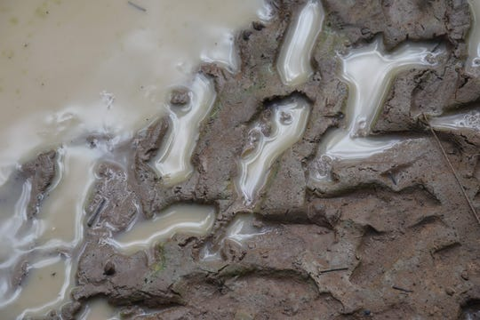 A file photo shows ATV tracks in the mud.