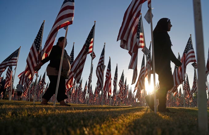 Hina Absar follows her daughter Sara Absar to her performance at the Healing Field at Tempe Beach Park in Tempe on Sept. 10, 2018.