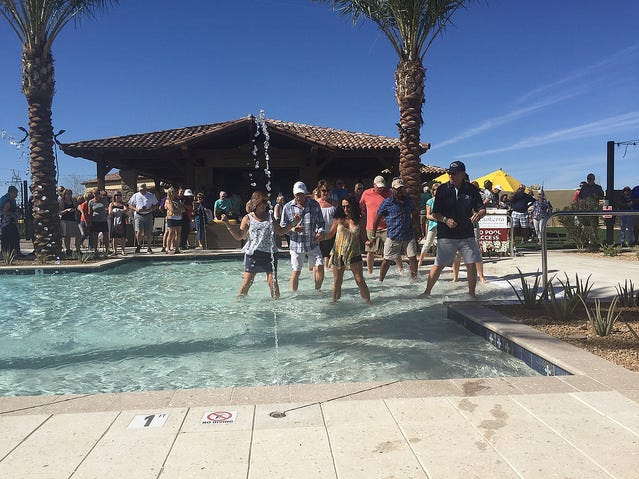 Encanterra Residents dancing at The Algarve's resort pool.