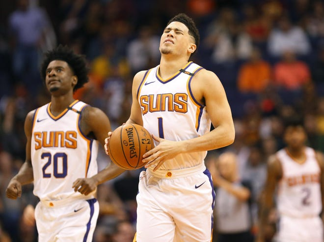 Phoenix Suns guard Devin Booker (1) reacts to a call against the Cleveland Cavaliers during the first quarter at University of Phoenix Stadium in Phoenix, Ariz. March 13, 2018.