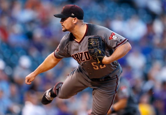 Arizona Diamondbacks starting pitcher Zack Godley works against the Colorado Rockies in the first inning of a baseball game against the Monday, Sept. 10, 2018, in Denver.