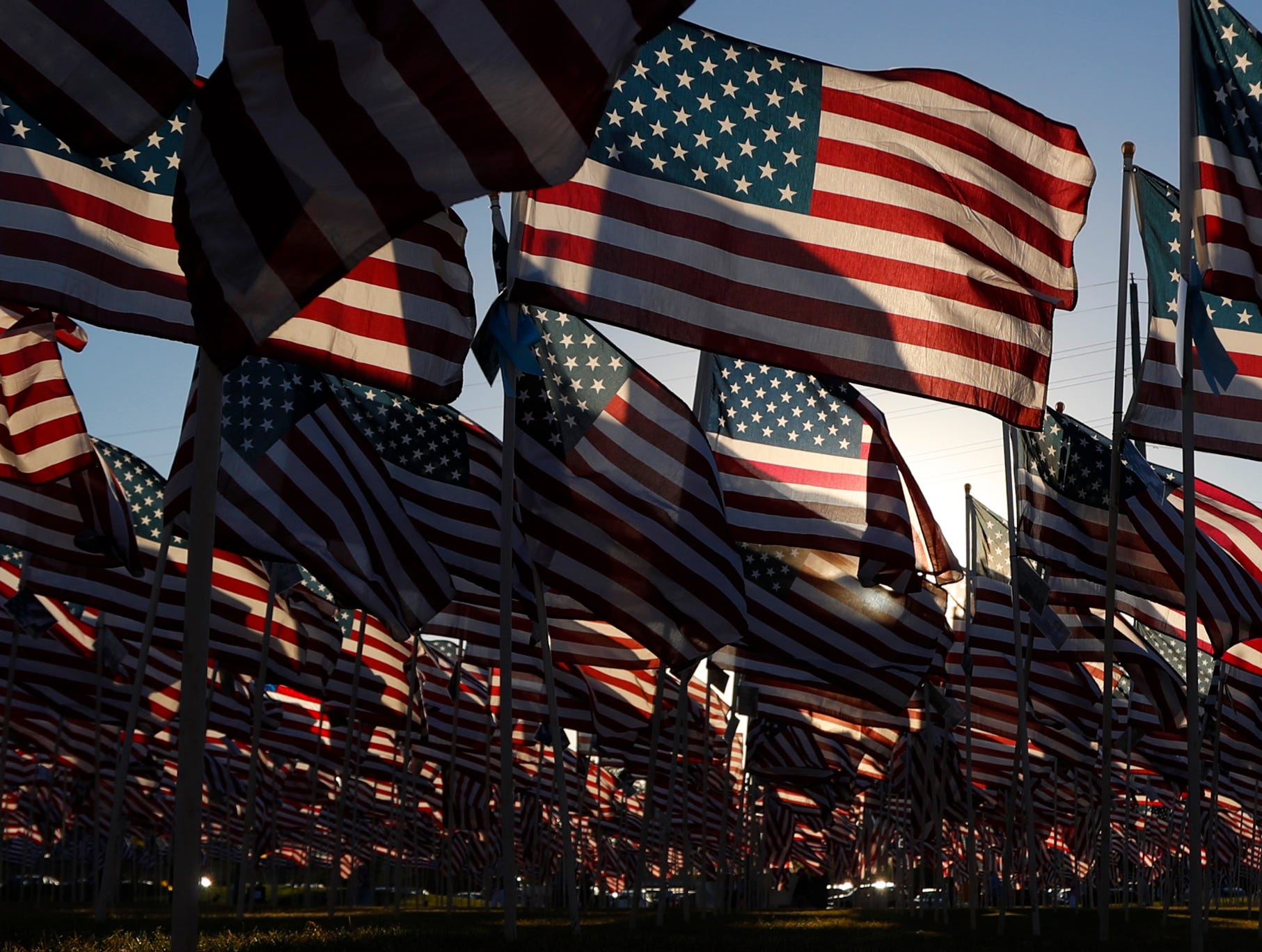 American flags wave in the wind at the Healing Field at Tempe Beach Park in Tempe on Sept. 10, 2018.