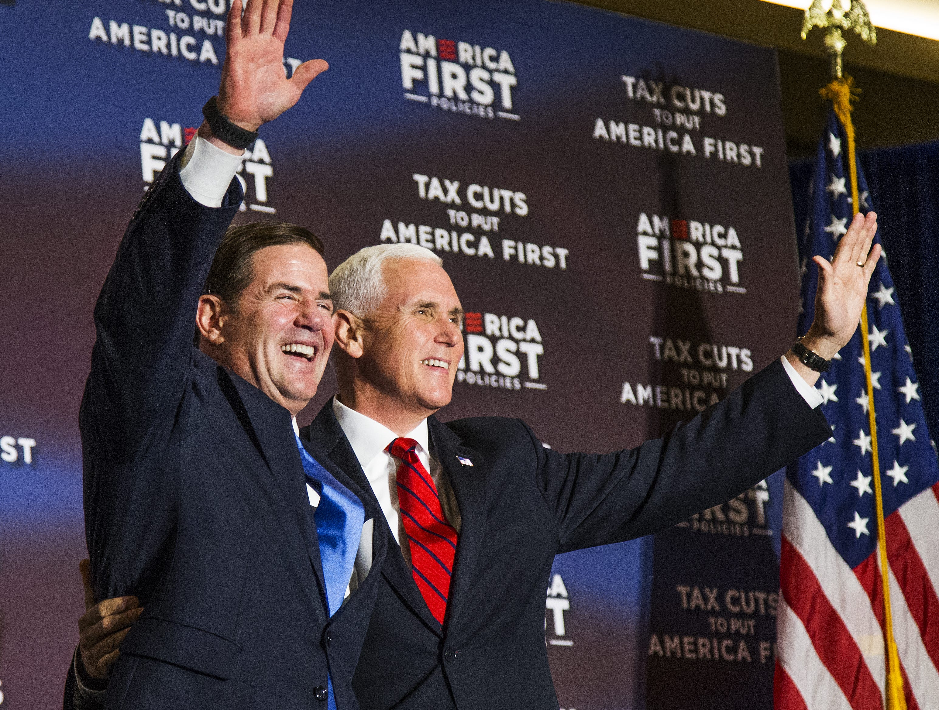 Gov. Doug Ducey welcomes Vice President Mike Pence on May 1, 2018, to the stage at the America First Policies event at the Phoenix Marriott Resort Tempe at The Buttes.