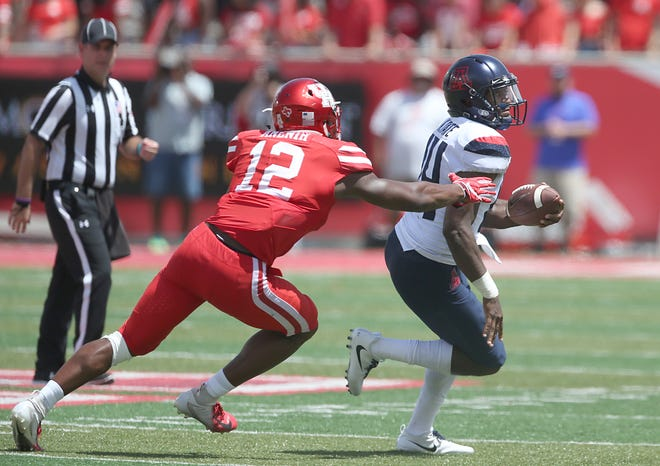 Khalil Tate #14 of the Arizona Wildcats breaks the tackle of David Anenih #12 of the Houston Cougars  in the third quarter at TDECU Stadium on September 8, 2018 in Houston, Texas. Houston won 45 to 18.