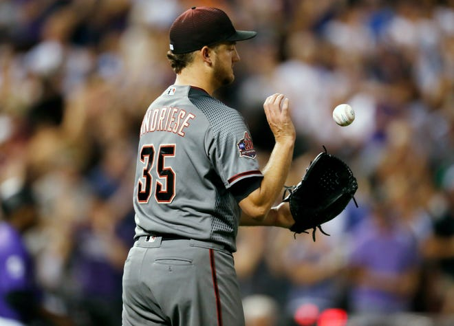 Arizona Diamondbacks relief pitcher Matt Andriese reacts after giving up a grand slam to Colorado Rockies' David Dahl in the seventh inning of a baseball game Monday, Sept. 10, 2018, in Denver.