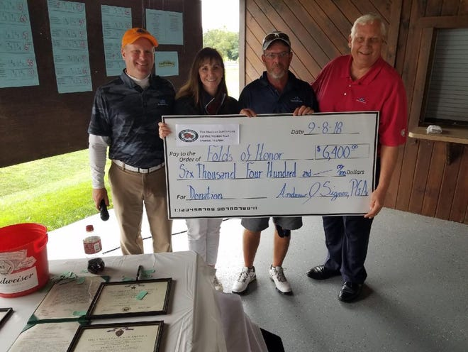 Presenting a check for $6400 to the Folds of Honor Foundation are, from left, Andy Signor, PGA Head Golf Professional Pine Meadows Golf Complex, Beth Simmons, President of the E PA/NJ Folds of Honor Chapter, Bill Beasley, Pine Meadows employee and Allen Wronoski, past president of the PGA of America and Folds of Honor employee.