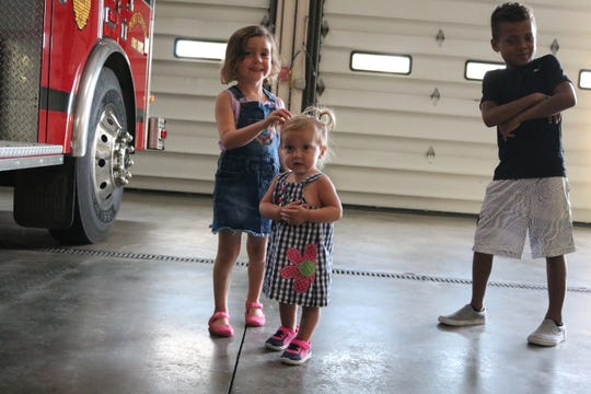 Vada Miller, 6, and Christian Miller, 8, check out fire trucks with thier little sister, Stella, who at 19-months-old is dealing with cystinosis, a rare genetic disease.
