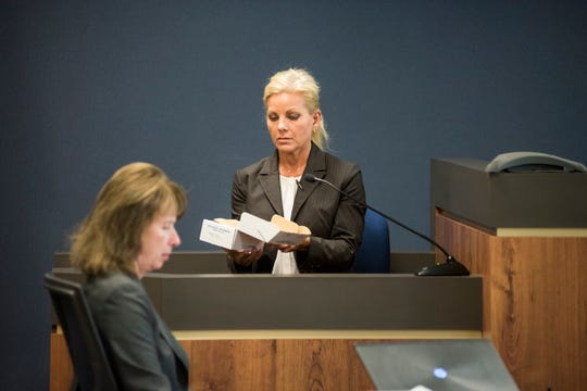 Port Huron Police Detective Malissa Martin, formerly McBride, describes a kit used to collect biological samples Tuesday, Sept. 11, 2018, during the trial for Theresa Gafken in the St. Clair County Courthouse.