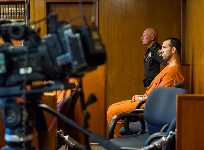 Joshua Michael Bauman waits in the jury box of District Judge Cynthia Platzer's courtroom Tuesday, Sept. 11, 2018, before his preliminary exam. Bauman is being charged in the fatal shooting on Aug. 24 of Port Huron Police Lt. Joel Wood and wounding two others.