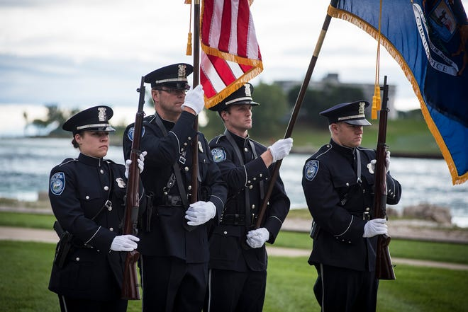 Officers from the Port Huron Police Department present the flags Tuesday, Sept. 11, 2018, during a memorial service at the International Flag Plaza in Port Huron.