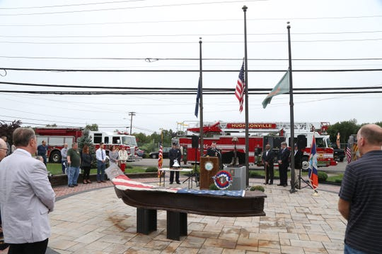 Town of Wappinger councilman William Beale speaks during Tuesday's memorial service commemorating the anniversary of 9/11 at Sgt. Mark Palmateer 9/11 Memorial Park in Wappingers Falls on September 11, 2018.