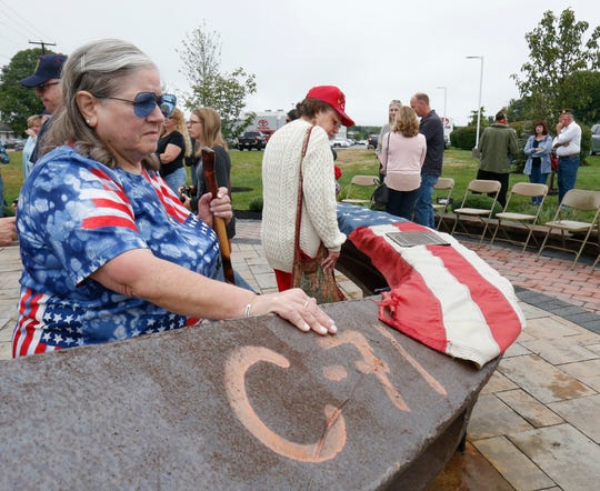 Joan Sommer of Wappingers Falls says a prayer to those who died in the 9/11 attacks during Tuesday's memorial commemorating the anniversary of 9/11 at Sgt. Mark Palmateer 9/11 Memorial Park in Wappingers Falls on September 11, 2018.