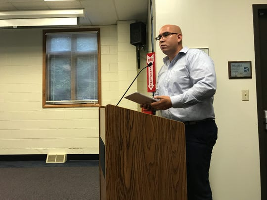 Elliot Garcia, Hyde Park's director of facilities and operations, discusses mold remediation efforts at a special school board meeting, held at district offices on Sept. 10, 2018.