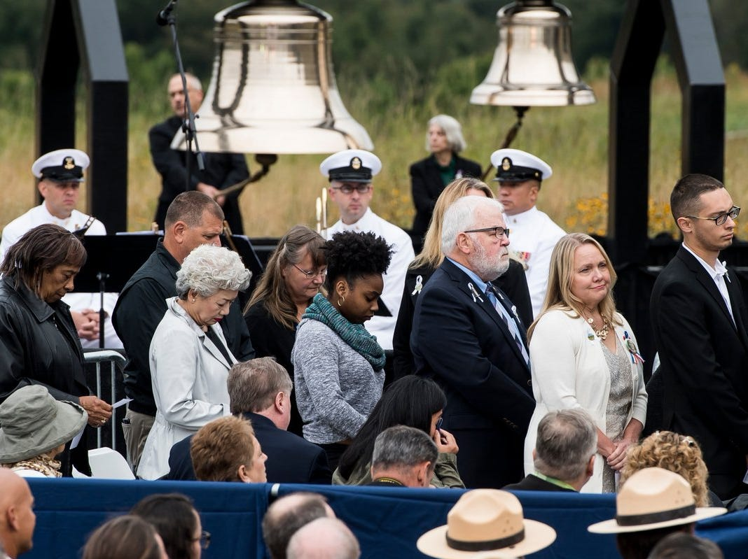 Family members of the 40 passengers and crew members killed in the Flight 93 terrorist attack wait in line to read the names of their loved ones during the 17th annual September 11 Observance in Shanksville, Pa., on Tuesday., Sept. 11, 2018