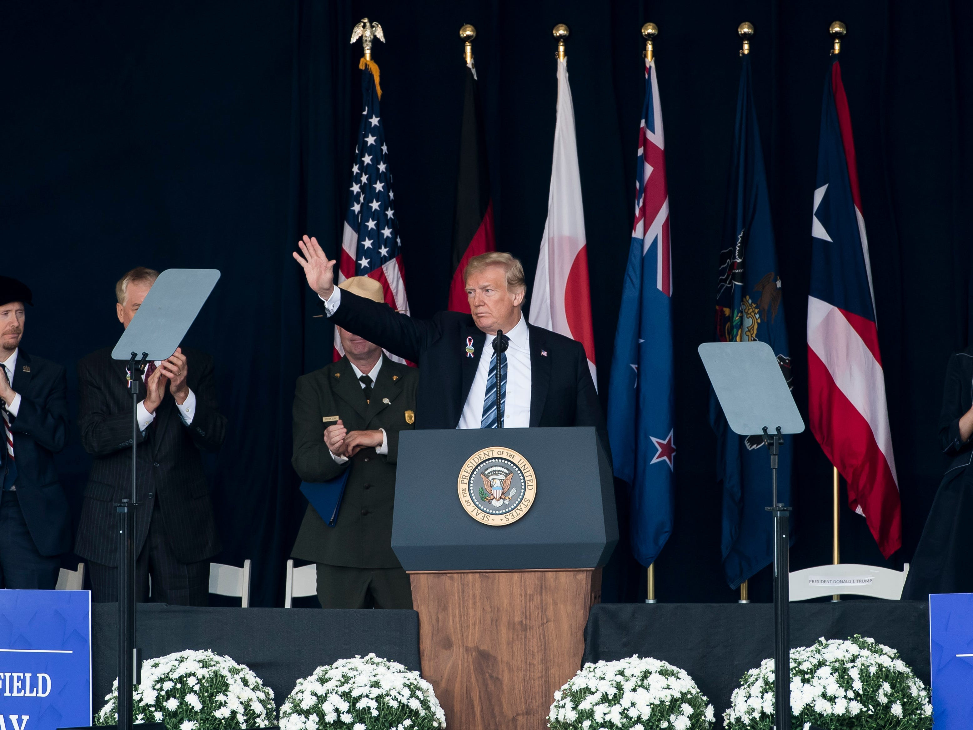 President Trump acknowledges the crowd after speaking at the Flight 93 National Memorial in Shanksville on Tuesday, September 11, 2018.