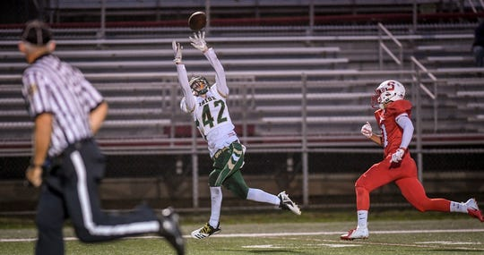 York Catholic's Benjamin Moir makes a leaping catch vs. Susquehannock earlier this season. The Fighting Irish (9-0) can sew up an outright York-Adams Division III title and an unbeaten regular season on Friday with a win vs. visiting York Tech. John A. Pavoncello photo