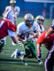 York Catholic's Massimo Antolick breaks through the line to score a touchdown against Susquehannock earlier this season. The Irish are 7-0 overall and 4-0 in York-Adams Division III. DISPATCH FILE PHOTO