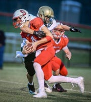 York Catholic linebacker Jarred Kohl, seen here tackling a Susquehannock player earlier this season, was selected the York-Adams League Division III Co-Defensive Player of the Year, with his brother, Harris.