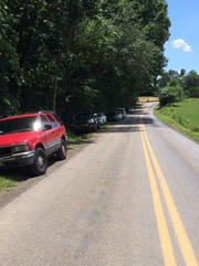 Cars parked along Clermont Mill Road, approximately a quarter mile from Kilgore Falls.