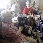 Elizabeth Wolford (left) and Lela Eye sit with their dog, Snoopy.