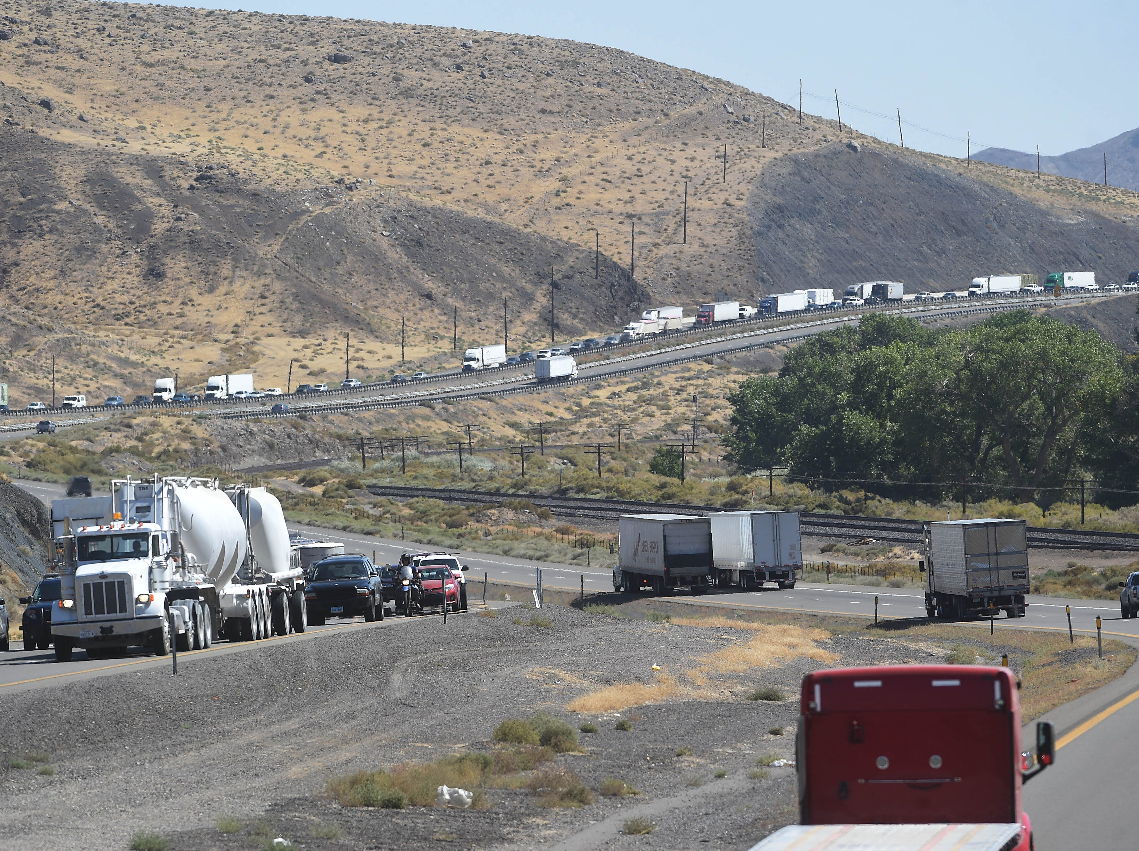 Traffic is seen backed up on west bound I-80 next to Derby Dam due to a roadside brush fire on Sept. 11, 2018.