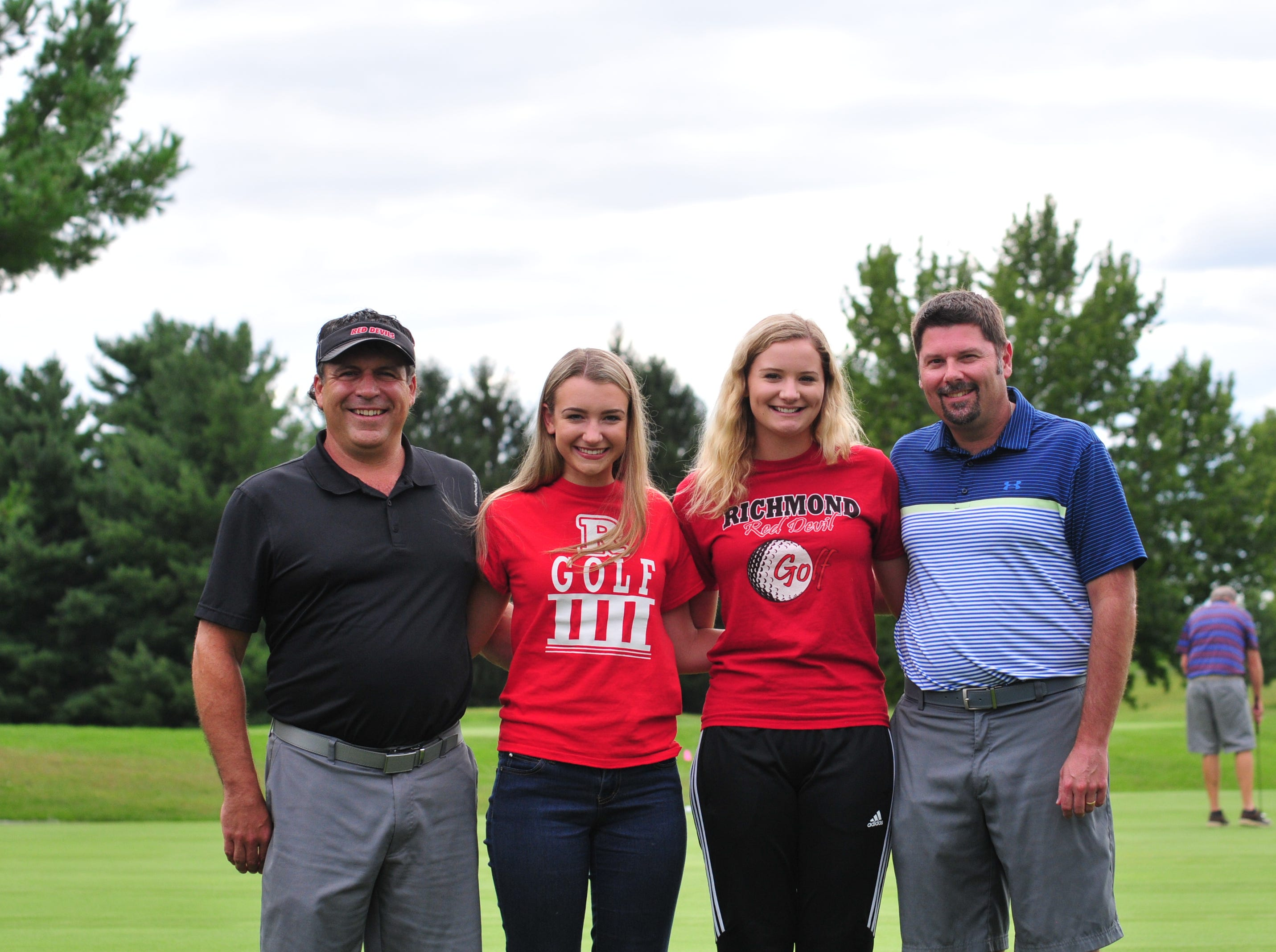 Richmond High School seniors Karissa Owens (second from left) and Jacey Cornett (third from left) led the Red Devils to an undefeated dual-match season. Karissa's father, Jesse Owens (left) started Richmond's Intermediate golf program, andJacey's father,  J. J. Cornett (right) was a member of Richmond's boys golf state title in 1993.