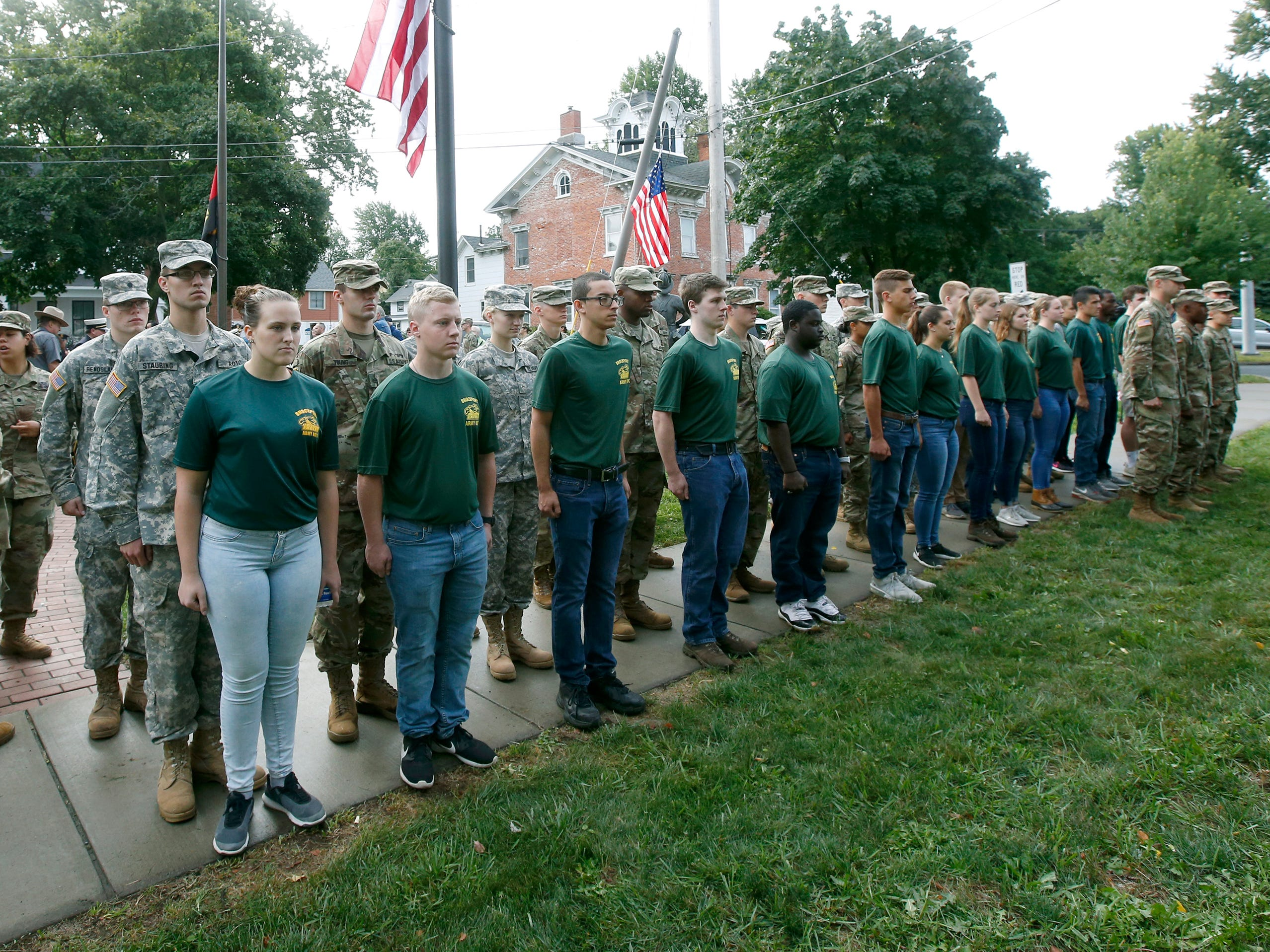 The Freedom Eagles, the College at Brockport's battalion for the ROTC program, stand in formation during the September 11th remembrance service at the Brockport Fire Department, Station 4.