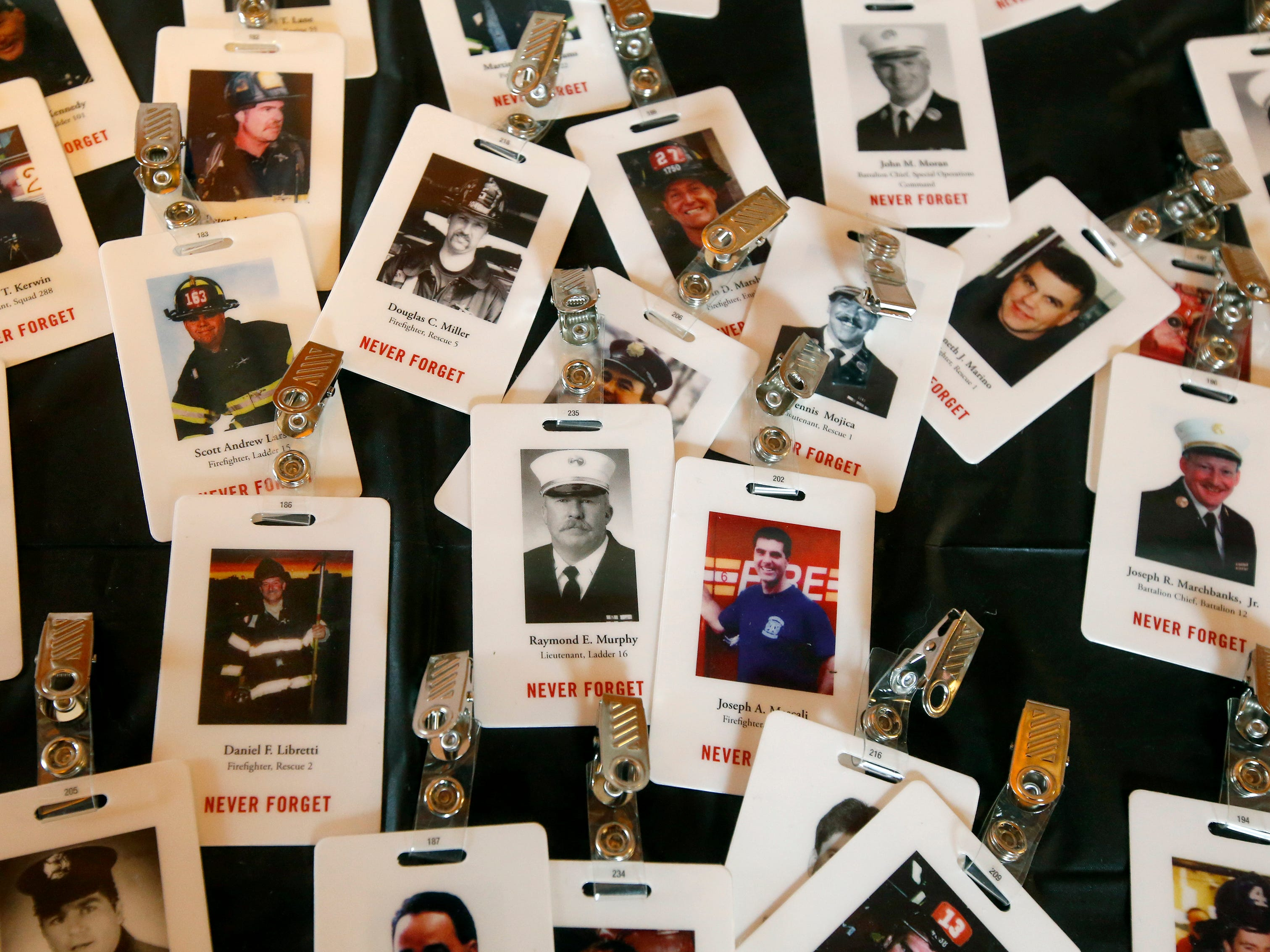 Tags with the names and photos of all the deceased firefighters from the Sept. 11, 2001, terrorist attacks, during the September 11th remembrance service at the Brockport Fire Department, Station 4.