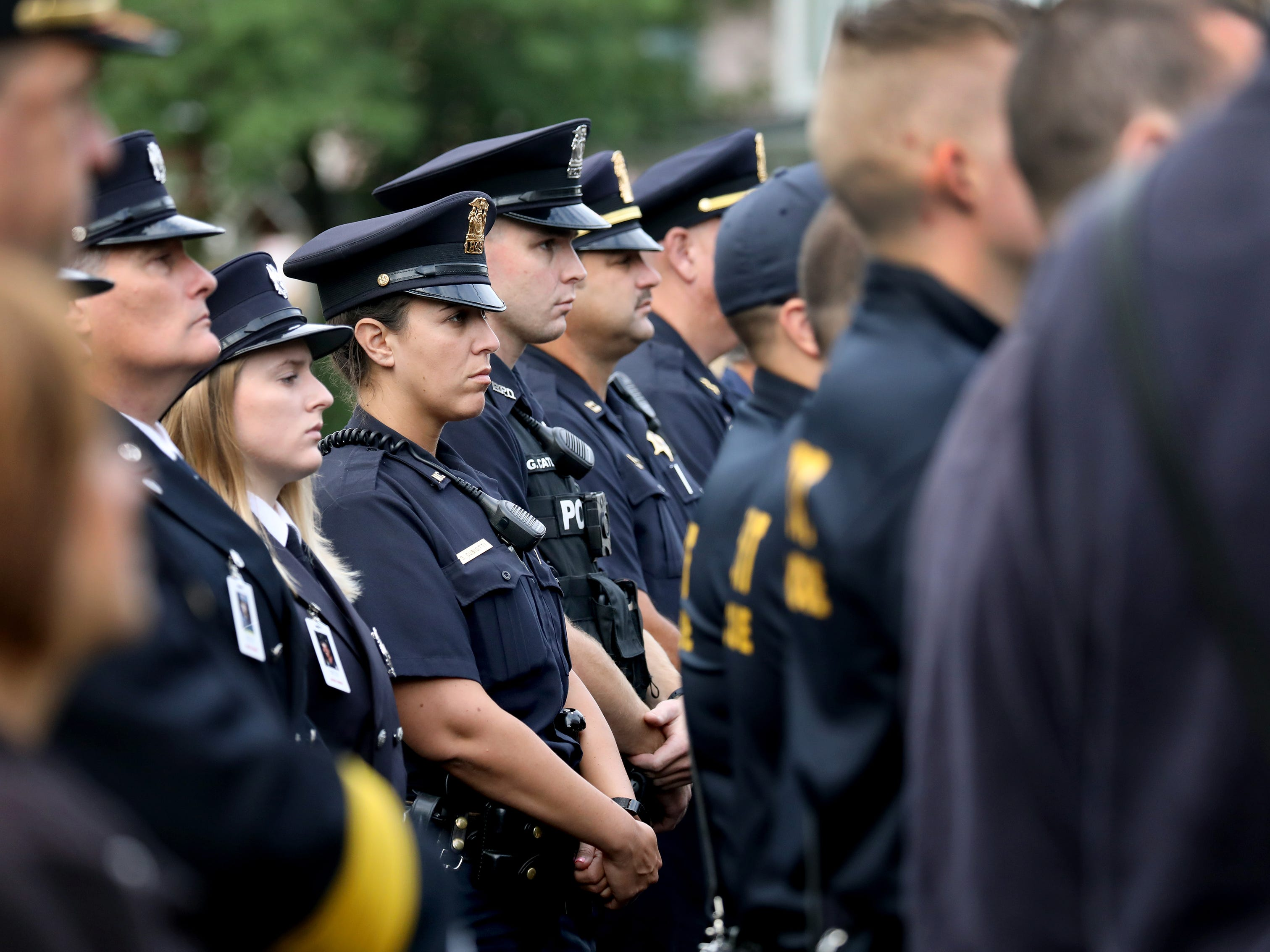 Members of law enforcement stand in formation as they join firefighters to pay their respects during the September 11th remembrance service at the Brockport Fire Department, Station 4.