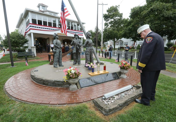 Assistant Chief Steve Dorgan looks at the 9/11 memorial before the remembrance service at the Brockport Fire Department, Station 4.
