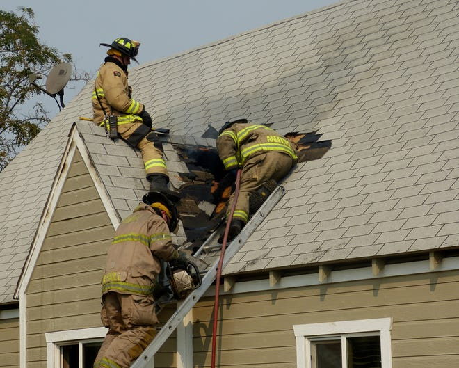 Firefighters battle a house fire off Westside Road Tuesday, Sept. 11, 2018, that caused extensive damage to the rental home and sent a woman to a Redding hospital for treatment of smoke inhalation. A cat also perished in the fire.