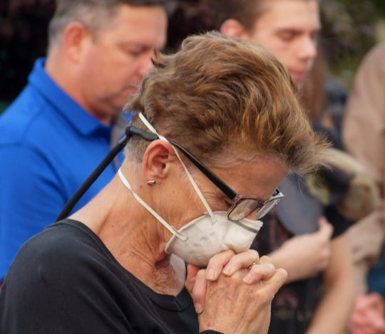 Colleen Palmer of Redding prays during a Tuesday, Sept. 11, 2018, observance marking the 17th anniversary of the 9/11 attacks.