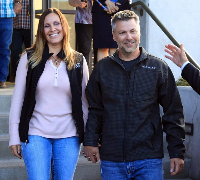 This photo provided by the Oregon Justice Resource Center shows Josh Horner with his wife Kelli Horner after a hearing in Bend, Ore., Monday, Sept. 10, 2018. A 50-year sentence in a sex abuse case against Horner was dismissed Monday by Deschutes County District Attorney John Hummel after the Oregon Innocence Project found holes in the 2017 conviction that undermined the credibility of the complainant, including that Horner had shot the dog in front of her.