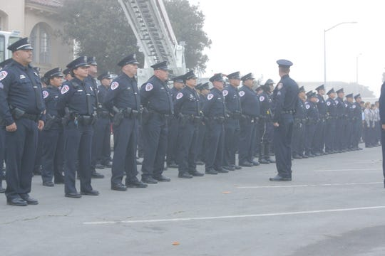 FILE: Salinas police officers stand at attention at a ceremony honoring the victims of the Sept. 11, 2001, attacks and first responders, 18 years after the fateful day. Salinas police officers and the union are clashing Sept. 10, 2019, over contract negotiations that have stalled.