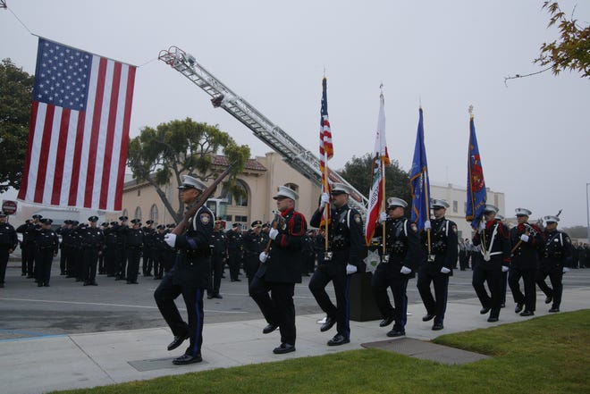 The Salinas Police Department's Color Guard pays tribute Tuesday to the victims of the terrorist attacks on Sept. 11, 2001.