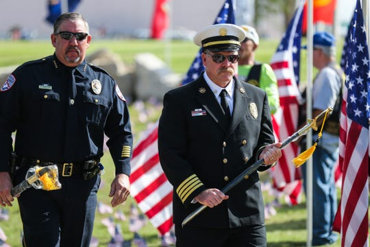 San Angelo Police Chief Frank Carter and San Angelo Fire Department Assistant Chief Todd Sanford leave the stage area with commemorative swords during the 9/11 Memorial Ceremony Tuesday, Sept. 11, 2018, at the monument near Celebration Bridge.
