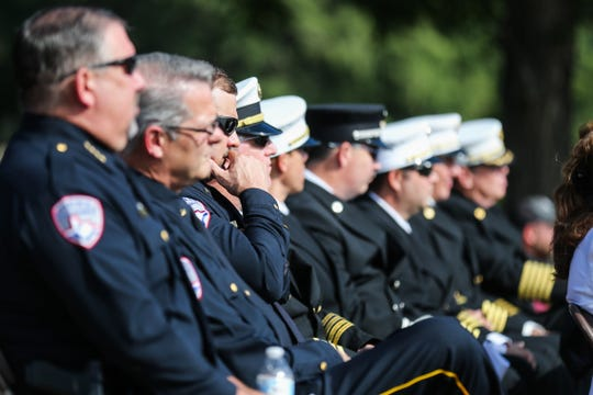 Members of the San Angelo Police Department listen to the speaker during a 9/11 Memorial Ceremony Tuesday, Sept. 11, 2018, at the monument near Celebration Bridge.